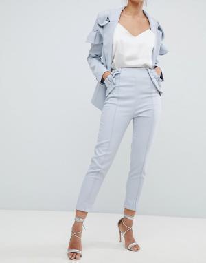 Elliatt Укороченные строгие брюки с оборками. Цвет: синий