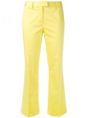 Классические брюки клеш Boutique Moschino. Цвет: жёлтый и оранжевый