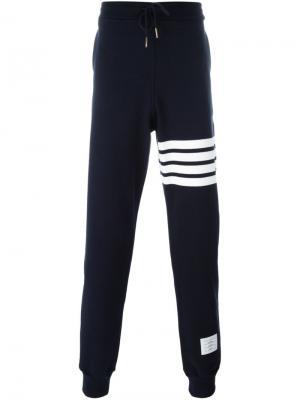 Спортивные брюки с заниженной шаговой линией Thom Browne. Цвет: синий