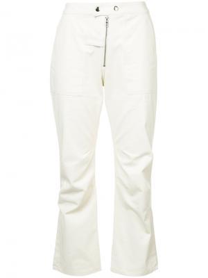 Укороченные брюки клеш Nomia. Цвет: телесный