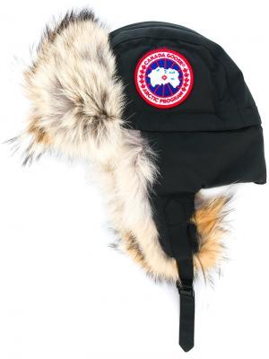 Шапка-ушанка с отделкой из меха койота Canada Goose. Цвет: чёрный