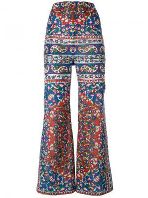 Расклешенные брюки с цветочным принтом Mes Demoiselles. Цвет: многоцветный