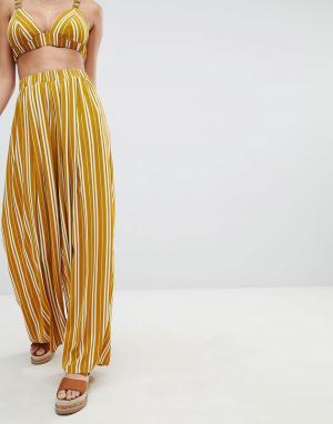 PrettyLittleThing Брюки с широкими штанинами в полоску. Цвет: желтый