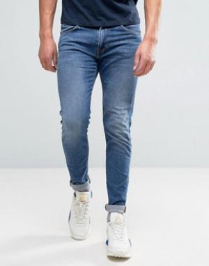 Edwin Суженные книзу джинсы с эффектом поношенности ED-85. Цвет: синий