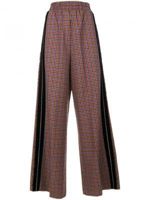 Расклешенные брюки в клетку Golden Goose Deluxe Brand. Цвет: многоцветный