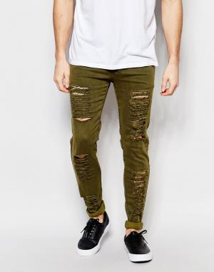 Other UK Рваные зауженные джинсы. Цвет: зеленый