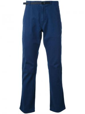 Узкие брюки-чинос Patagonia. Цвет: синий