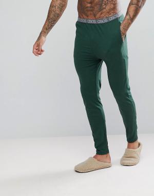 ASOS Трикотажные пижамные брюки узкого кроя с фирменным поясом. Цвет: зеленый