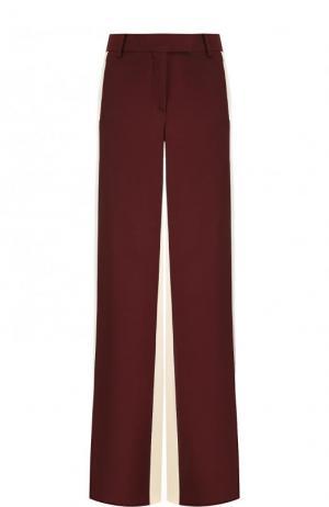 Шелковые расклешенные брюки с карманами Valentino. Цвет: бордовый