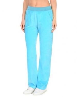Пляжные брюки и шорты VERSACE. Цвет: лазурный