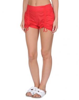 Пляжные брюки и шорты EMPORIO ARMANI SWIMWEAR. Цвет: красный
