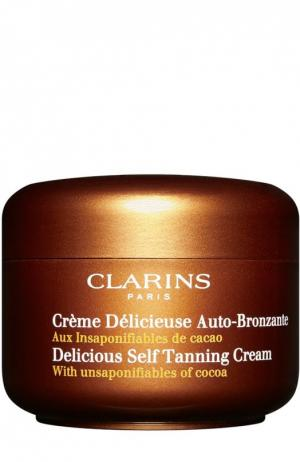 Крем для искусственного загара с фруктовым ароматом Clarins. Цвет: бесцветный