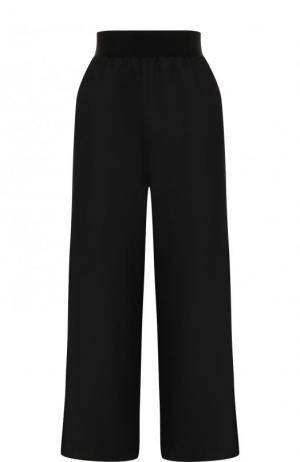 Однотонные расклешенные брюки из шерсти Maison Margiela. Цвет: черный
