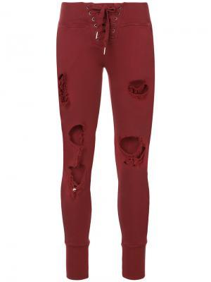 Рваные брюки NSF. Цвет: красный