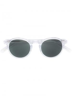 Солнцезащитные очки в круглой оправе Moscot. Цвет: телесный
