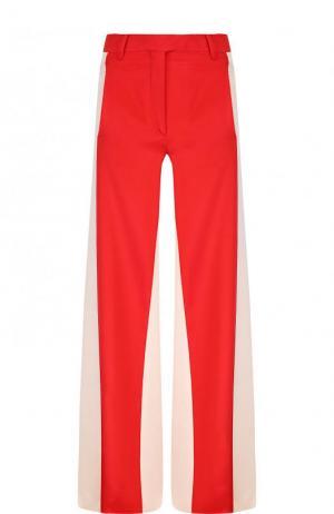 Шелковые расклешенные брюки с карманами Valentino. Цвет: красный