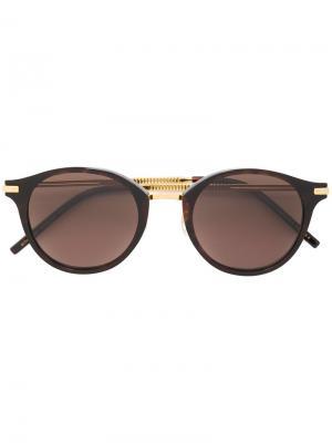 Круглые солнцезащитные очки Boucheron. Цвет: коричневый