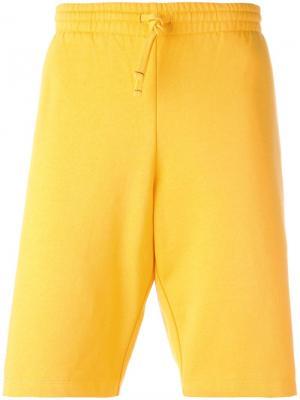 Спортивные шорты Squash Futur. Цвет: жёлтый и оранжевый