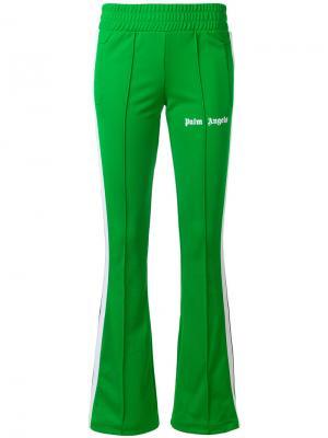 Расклешенные спортивные брюки Palm Angels. Цвет: зелёный