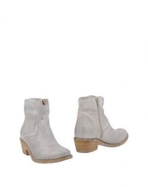 Полусапоги и высокие ботинки FABRIZIO CHINI. Цвет: серебристый