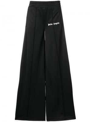 Расклешенные спортивные брюки Palm Angels. Цвет: чёрный