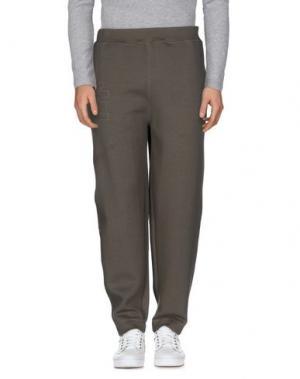 Повседневные брюки ÉTUDES STUDIO. Цвет: зеленый-милитари