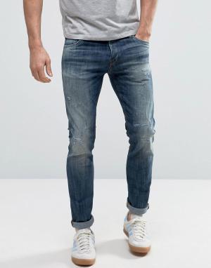 Jack & Jones Узкие джинсы с рваной отделкой Intelligence. Цвет: синий