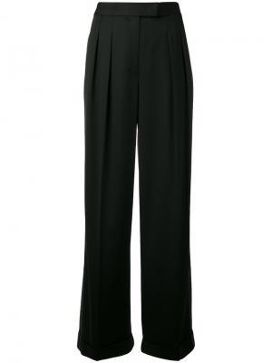 Двухцветные брюки DKNY. Цвет: чёрный