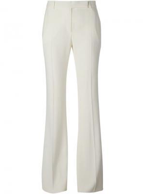Расклешённые брюки Alexander McQueen. Цвет: белый