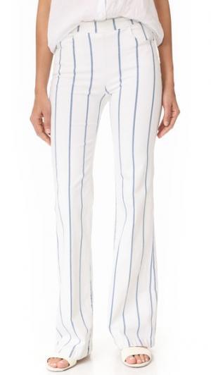 Расклешенные брюки с молниями по бокам FRAME. Цвет: hauser