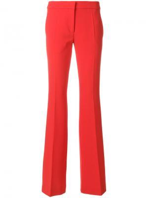 Расклешенные брюки узкого кроя Moschino. Цвет: красный