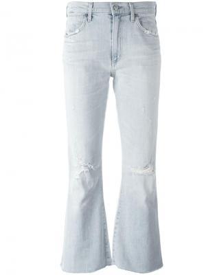 Расклешенные джинсы с потертой отделкой Citizens Of Humanity. Цвет: синий
