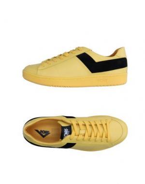Низкие кеды и кроссовки PONY. Цвет: желтый