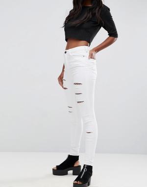 ASOS Белые рваные джинсы скинни с завышенной талией RIDLEY. Цвет: белый