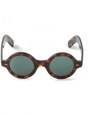 Круглые солнцезащитные очки Cutler & Gross. Цвет: коричневый
