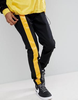 ASOS Черные джоггеры скинни с желтыми полосками. Цвет: черный