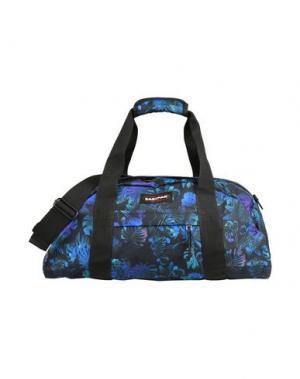 Дорожная сумка EASTPAK. Цвет: фиолетовый