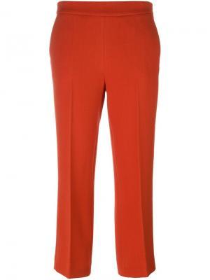 Узкие укороченные брюки Odeeh. Цвет: красный