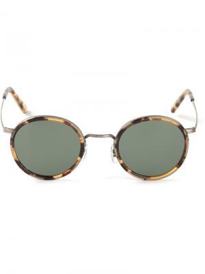 Солнцезащитные очки в круглой оправе Masunaga. Цвет: телесный