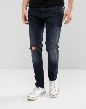 Just Junkies Темные суженные джинсы с рваной отделкой. Цвет: синий