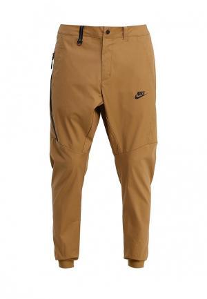 Брюки спортивные Nike. Цвет: коричневый