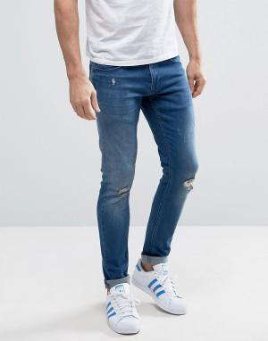 Redefined Rebel Узкие джинсы цвета индиго. Цвет: синий