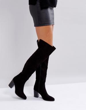 London Rebel Сапоги-ботфорты на каблуке. Цвет: черный