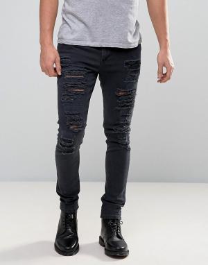 ASOS Супероблегающие рваные джинсы. Цвет: черный