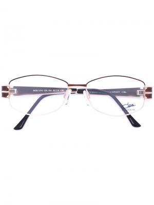 Очки с эмалированной овальной оправой Cazal. Цвет: металлический