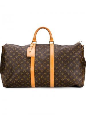 Дорожная сумка с монограммным принтом Louis Vuitton Vintage. Цвет: коричневый