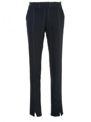 Узкие строгие брюки Maison Flaneur. Цвет: синий