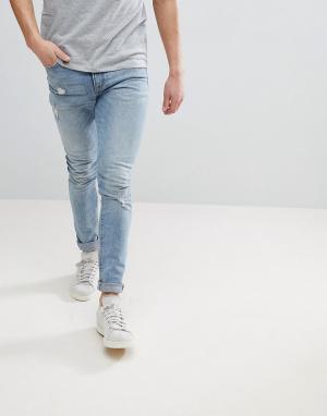 ASOS Голубые потертые джинсы скинни DESIGN. Цвет: синий