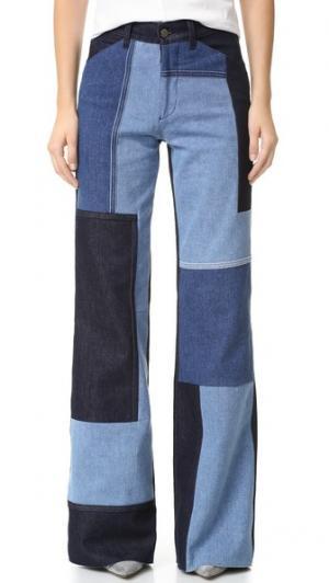 Широкие джинсы Victoria Beckham. Цвет: голубые заплатки