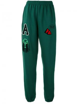 Спортивные брюки со вставками Aries. Цвет: зелёный